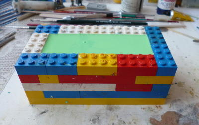 picture of cast rubber encased in Lego